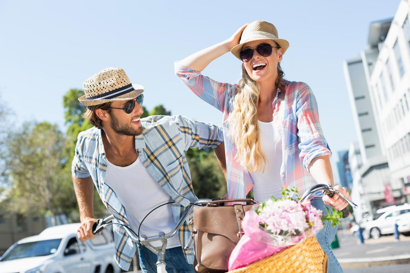 photodune-10212881-attractive-couple-on-a-bike-ride-on-a-sunny-day-in-the-city-s