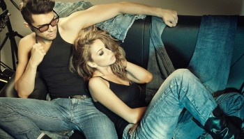 photodune-3346369-sexy-man-and-woman-dressed-in-jeans-doing-a-fashion-photo-shoot-in-a-professional-studio-s